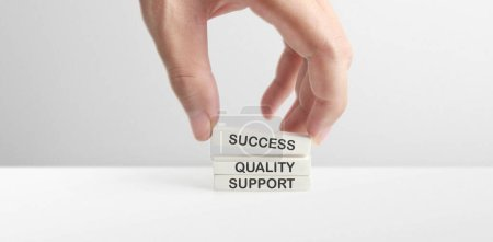Photo for Cube with words success, company, support, quali ty, mission, business, in hand. personal development - Royalty Free Image