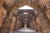 Ancient fort ruined city at Mandu, Madhya Pradesh, India. Arched architecture in the palace Jahaz Mahal, India
