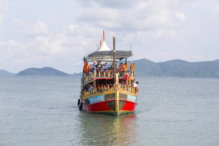 KOH CHANG, THAILAND - MAY 01, 2017 : Colorful boat with tourists returns from a cruise to the island of Koh Chang, Thailand. The island Koh Chang is very popular among tourists.