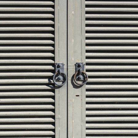 Photo for Closed metal shutters blinds and window handle, close up - Royalty Free Image
