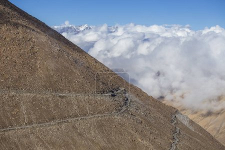 Photo for View of winding road and majestic rocky mountains in Indian Himalayas, Ladakh region, India. Nature and travel concept - Royalty Free Image