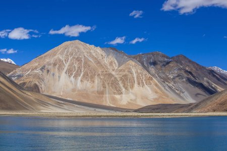 Photo for View of majestic rocky mountains against the blue sky and lake Pangong in Indian Himalayas, Ladakh region, Jammu and Kashmir, India. Nature and travel concept - Royalty Free Image