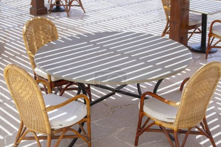 Photo for Table and chairs in beach cafe next to the red sea in Sharm el Sheikh, Egypt, close up - Royalty Free Image