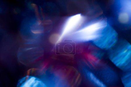 Aquamarine gleams illuminating in soft focus on bokeh background