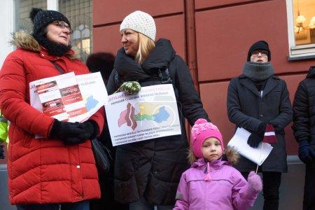 Photo pour RIGA, LATVIA - JANUARY 22ND, 2019: Demonstration against new coalition of government of Latvia outside Saeima building, Parliament of Latvia. - image libre de droit