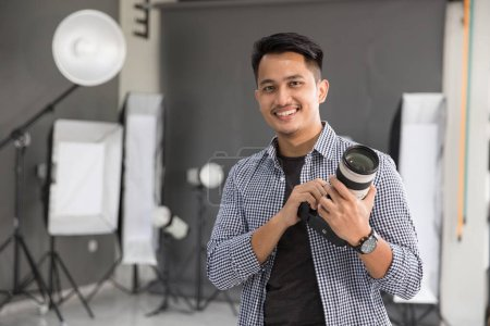 young man photographer smiling