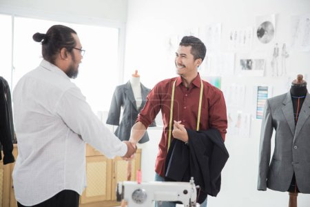 tailor with his customer talking