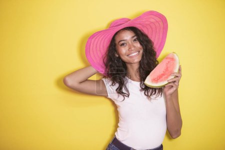 beautiful asian girl wearing summer hat with fresh watermelon