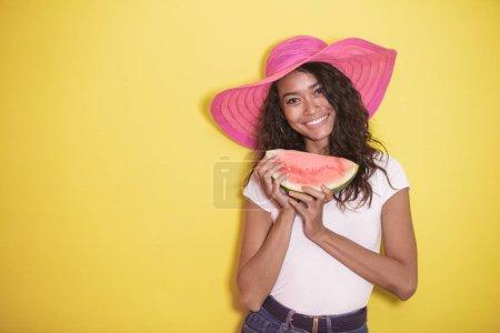 beautiful asian girl wearing summer hat with fresh watermelon