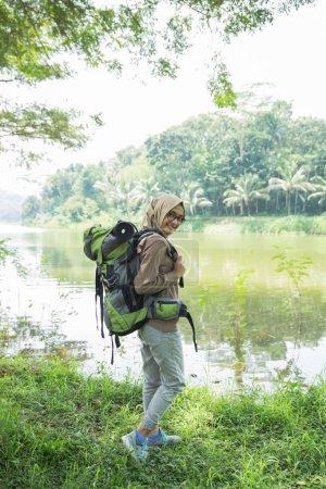 woman hiker hiking on mountain trail