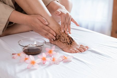 beauty scrub and mask to her leg