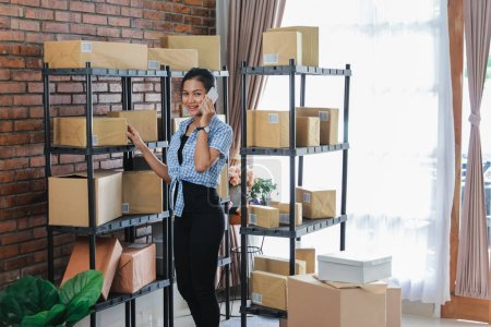 busy asian woman online seller