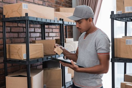 man checking packages