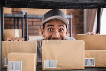 man working in packages shelf