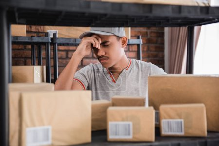 stressed young man checking packages