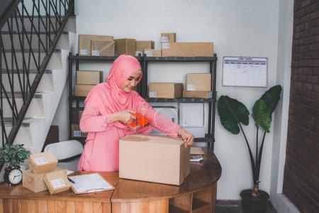 ecommerce entrepreneur preparing product