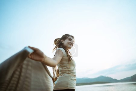 portrait caucasian women raise arm with blangket relax side the