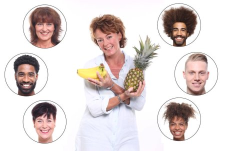 Photo for Adult woman with pineapple and bananas and set of interracial people - Royalty Free Image