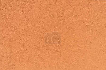 vue rapprochée d'orange rugueuse tanné fond texturé