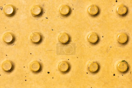 close-up view of yellow rough weathered metal background