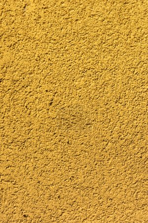 close-up view of yellow rough wall textured background