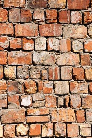 Photo pour Vue rapprochée du vieux mur de briques rouges fond texturé - image libre de droit