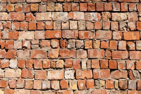 Photo pour Mur de vieilles briques rouges fond texturé - image libre de droit