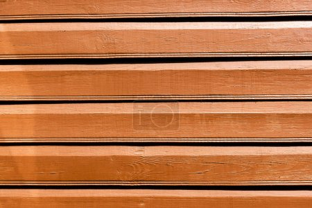close-up view of brown wooden background with horizontal planks