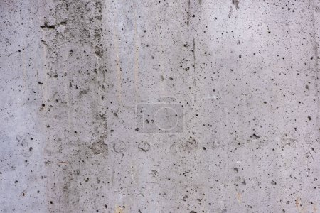 full frame view of grey rough scratched concrete wall texture