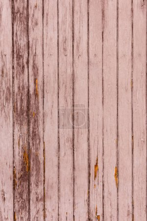 Photo for Old scratched brown wooden fence background with vertical planks - Royalty Free Image