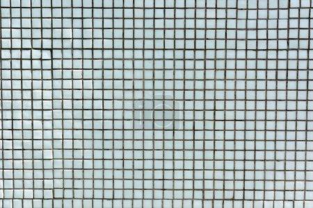 full frame view of light blue tiles background