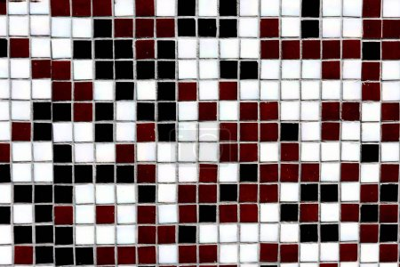 close-up view of black, white and maroon decorative tiles background
