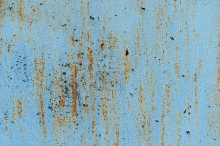 old scratched blue background with rust texture