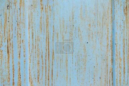 old scratched blue background with rust
