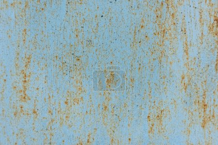 close-up view of old scratched blue wall with rust background