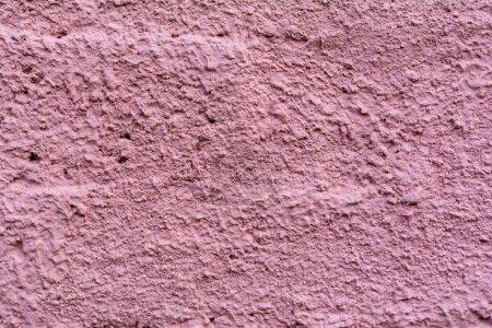 Foto de Vista cercana de cemento púrpura vieja pared textura de fondo - Imagen libre de derechos