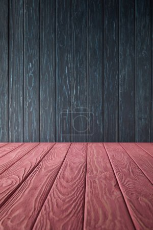 pink wooden table and dark blue wooden wall