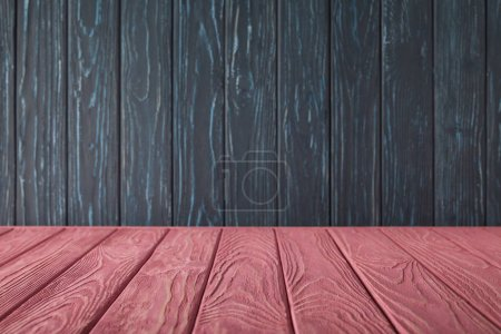 pink striped tabletop and dark blue wooden wall