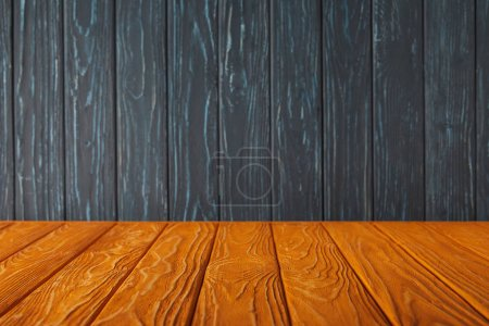 orange striped tabletop and dark blue wooden wall