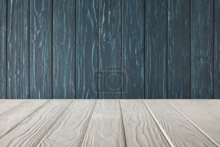 white striped tabletop and dark blue wooden wall