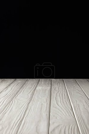 white striped wooden tabletop on black