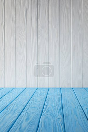 blue striped tabletop and white wooden wall