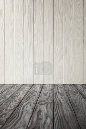 grey wooden tabletop and white wooden wall
