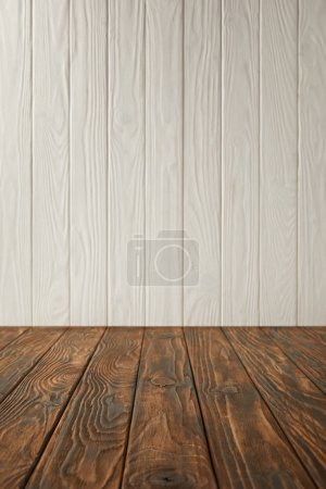 dark brown striped tabletop and white wooden wall