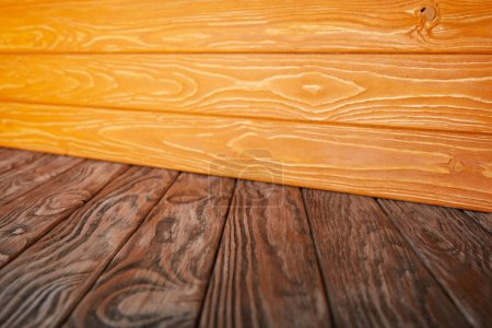brown wooden striped floor and orange wooden wall