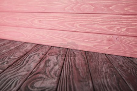 grey wooden floor and pink striped wooden wall
