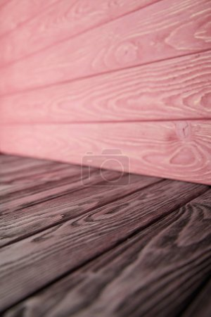 grey wooden floor and pink wooden wall