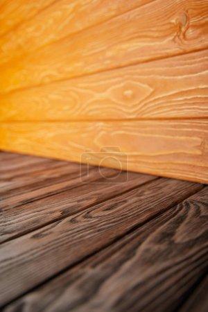 brown wooden floor and orange wooden wall