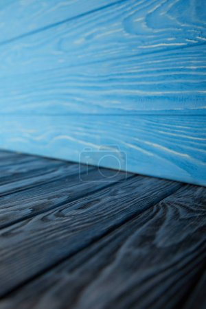 dark blue wooden floor and light blue wooden wall