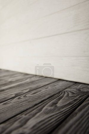 grey wooden floor and white wooden wall